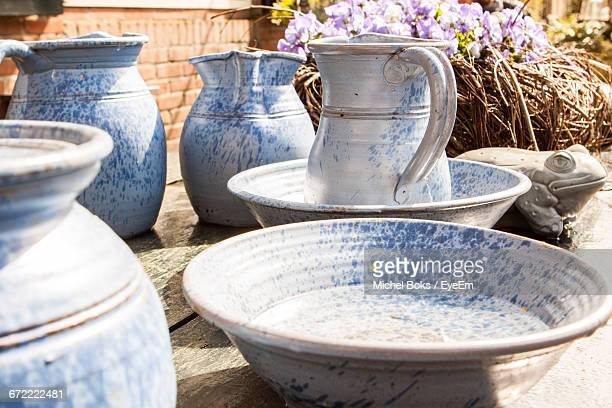 View Of Basin And Jugs On Table With Flowers