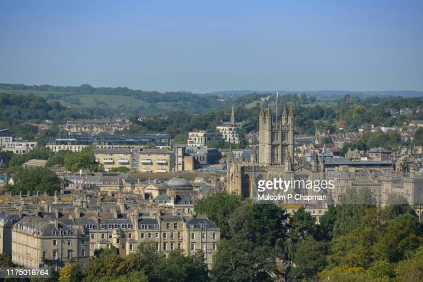 view of bath, including the gothic bath abbey, somerset, uk from bath skyline - bath england stock pictures, royalty-free photos & images