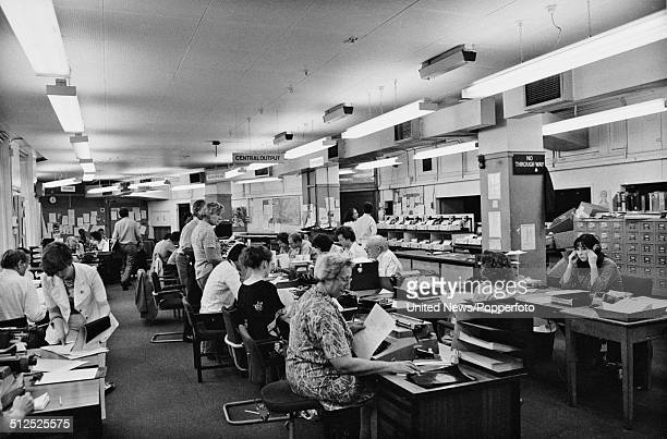View of BBC staff working in a production office in Bush House home of BBC World Service at Aldwych in London on 30th August 1979
