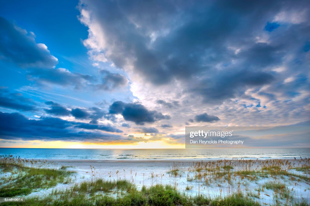 View of Beach against a blue sky with clouds : Stock Photo