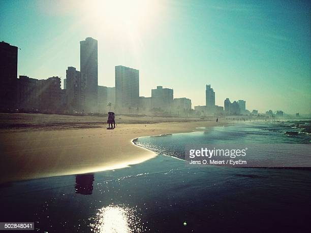 view of beach against buildings on sunny day - durban stock pictures, royalty-free photos & images