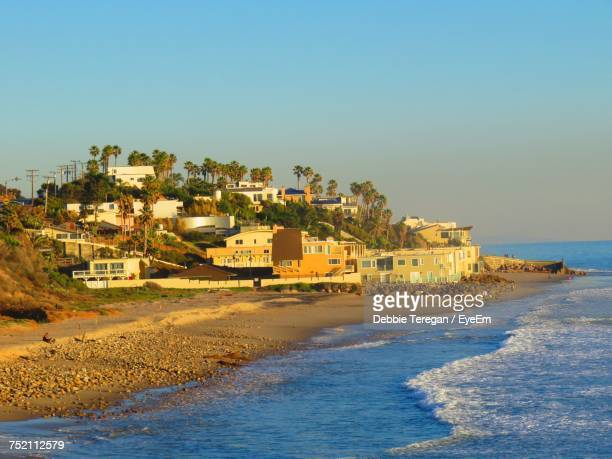 view of beach against clear sky - malibu stock pictures, royalty-free photos & images