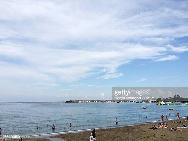 view of beach against cloudy sky - giardini naxos stock pictures, royalty-free photos & images