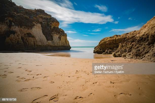 view of beach against cloudy sky - alvor stock pictures, royalty-free photos & images