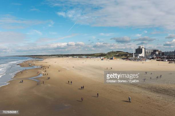 view of beach against cloudy sky - bortes stock photos and pictures