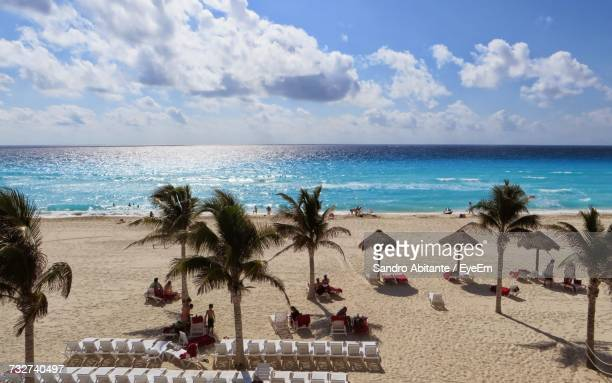 view of beach against cloudy sky - quintana roo stock photos and pictures