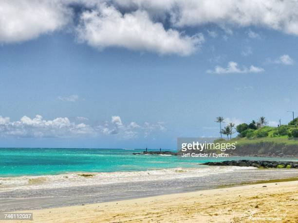 view of beach against cloudy sky - kailua stock pictures, royalty-free photos & images