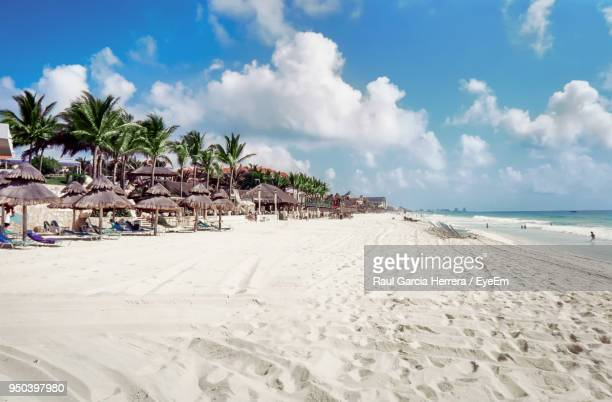 view of beach against cloudy sky - cancun stock pictures, royalty-free photos & images