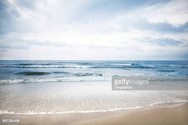 view of beach and clouds - coastline stock photos and pictures