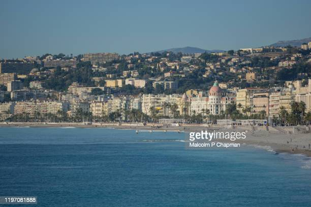 view of beach and towards the promenade des anglais, nice, france - nice france stock pictures, royalty-free photos & images