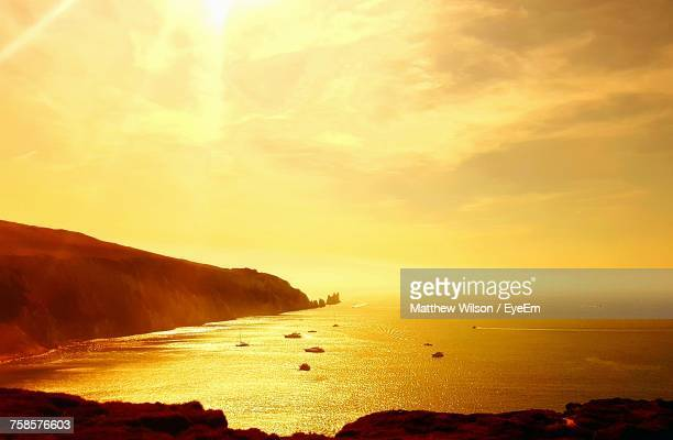 view of beach at sunset - alum bay stock pictures, royalty-free photos & images