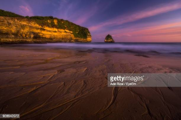 view of beach at sunset - ade rizal stock photos and pictures