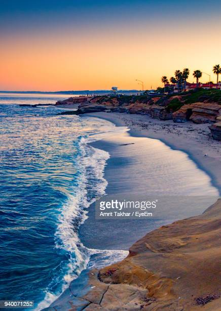 view of beach at sunset - la jolla stock pictures, royalty-free photos & images