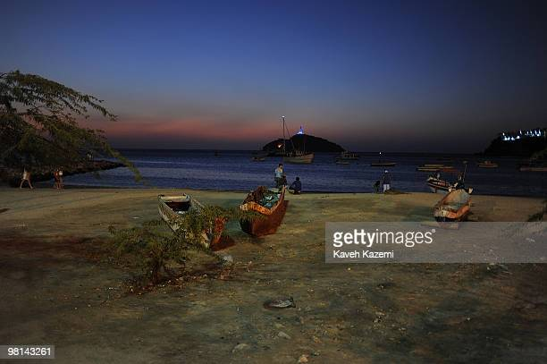 A view of beach front at night with fishing boats at shore and a large tanker at sea Santa Marta is a city and municipality located in northern...