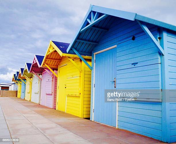 View Of Beach Huts Against Blue Sky