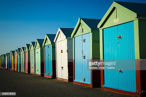 View Of Beach Huts Against Clear Sky