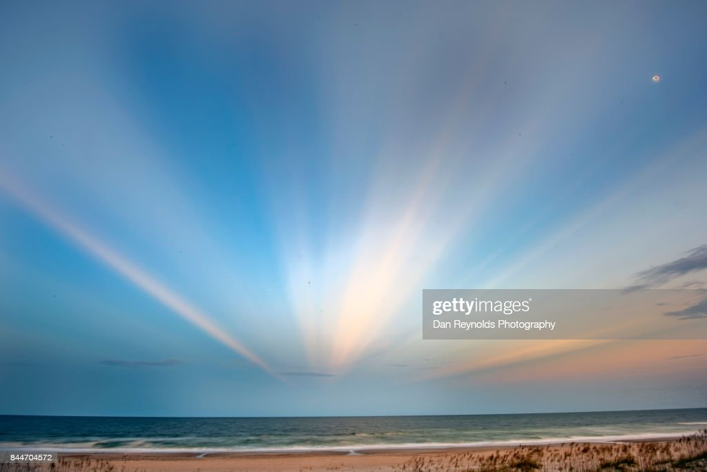 View of beach on island at twilight : Stock Photo