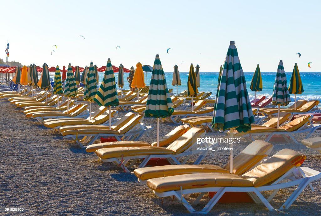 view of beach with chairs and umbrellas. Greece.