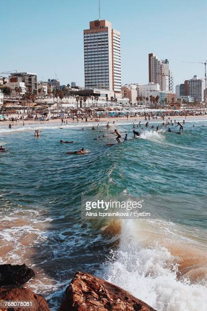 view of beach with city in background - tel aviv stock pictures, royalty-free photos & images