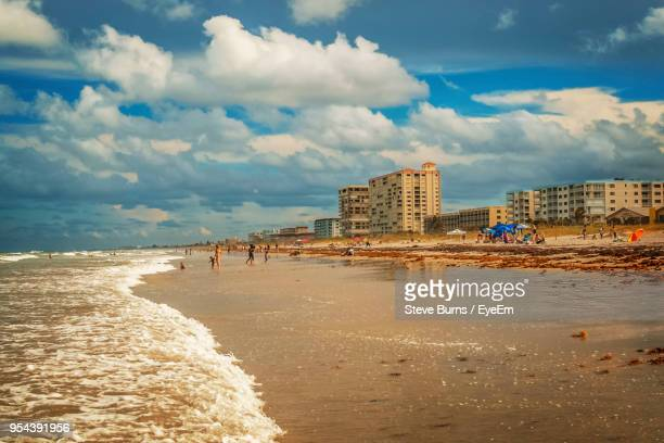 view of beach with city in background - cocoa beach stock pictures, royalty-free photos & images