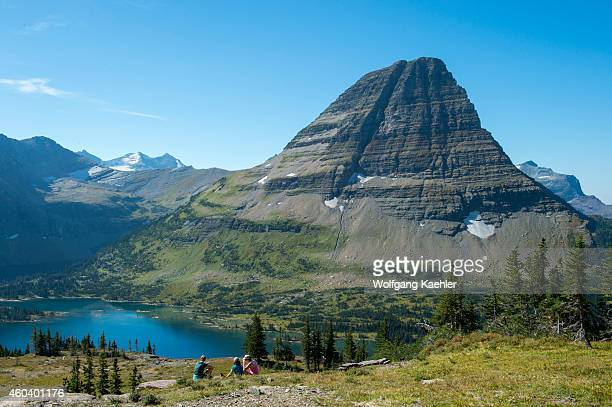 View of Bearhat Mountain above Hidden Lake at Logan Pass in Glacier National Park Montana United States with people in foreground