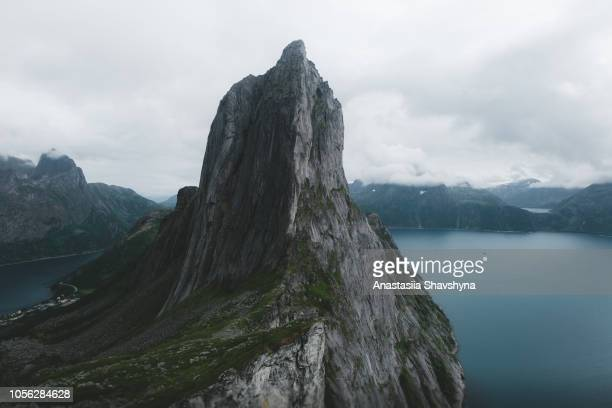 view of beautiful segla mountain and sea in northern norway - dramatic landscape stock pictures, royalty-free photos & images
