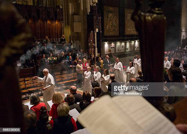 View of beginning of a Christmas Day service at the Cathedral Church of Saint John the Divine New York New York December 25 2015 Construction of the...