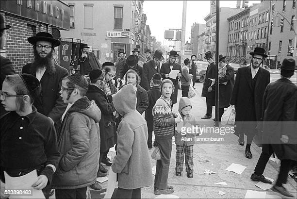 View of Belzer Chassidim on a crowded street in Williamsburg Brooklyn New York New York November 2 1979