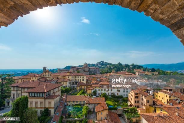 view of bergamo from the old town tower campanone torre civica, bergamo, province of bergamo, lombardy, italy - bergamo fotografías e imágenes de stock