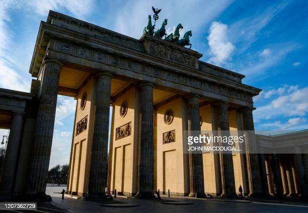 View of Berlin's Brandenburg Gate, devoid of tourists, due to the COVID-19 coronavirus, on March 16, 2020.