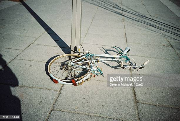 View Of Bicycle With One Wheel Stolen