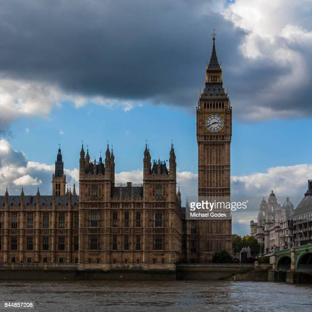 view of big ben and parliament from across the thames river - historical geopolitical location stock photos and pictures