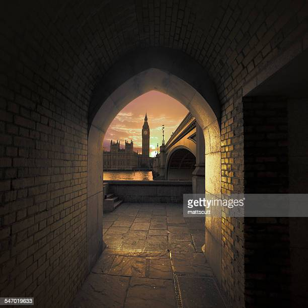 View of Big Ben through an arch across the River Thames, London, UK