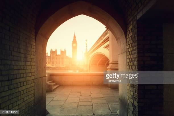 View of Big Ben through the pointed arch at sunset