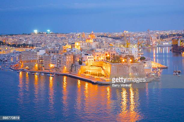 view of birgu at dusk - valletta stock pictures, royalty-free photos & images