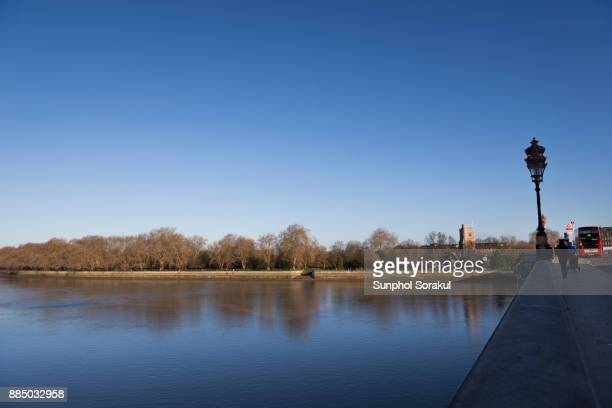 View of Bishop's park and All Saints Church from Putney Bridge, London, UK