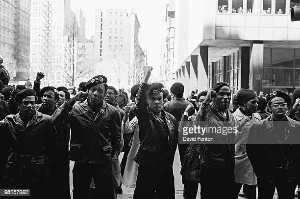 View of Black Panther Party members as they demonstrate, fists raised, on Centre Street , New York, New York, April 11, 1969. The demonstration was...