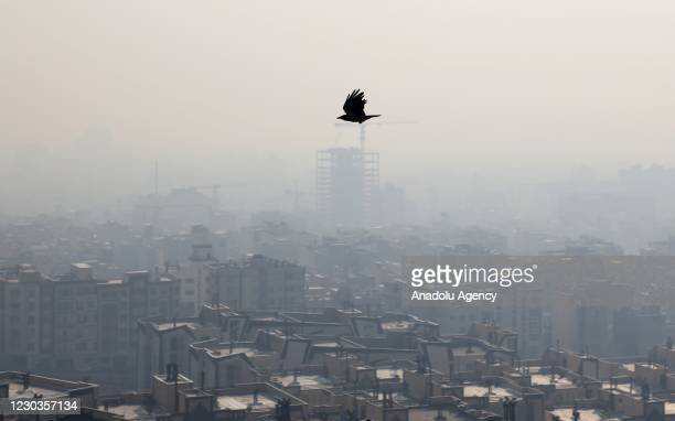 View of blanket of smog covering the city as heavy air pollution hit the city on December 30, 2020 in Tehran, Iran. It has been announced that in...