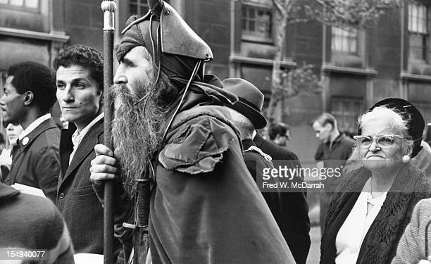 View of blind American composer, musician, poet, and eccentric Moondog as he participates in an Anti-Vietnam War march, New York, New York, October...