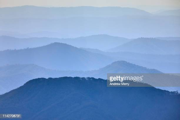 view of blue distant mountains from mount kosciuszko, australia - great dividing range stock-fotos und bilder