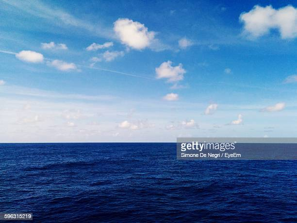 View Of Blue Sea Against Cloudy Sky