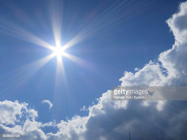 View of blue sky and clouds with sunrays