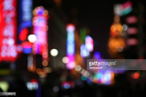A view of blurred neon lights in the city