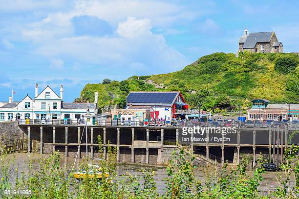 view of boardwalk against cloudy sky - ilfracombe stock pictures, royalty-free photos & images