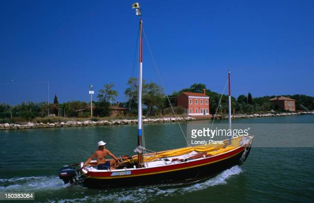 View of boat and Torcello Island from Vaporetto (ferry).