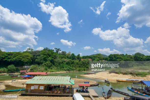 view of boat jetty on tembeling river, taman negara national park, malaysia. - shaifulzamri foto e immagini stock