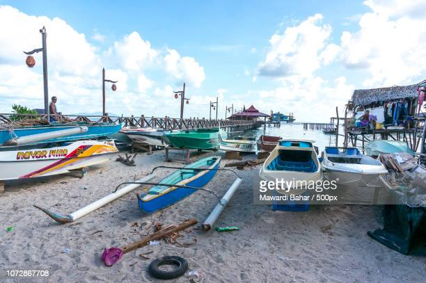 sabah, malaysia - august 16, 2016 : a view of boats at mabul island villages. the coral seas around - mabul island stock photos and pictures