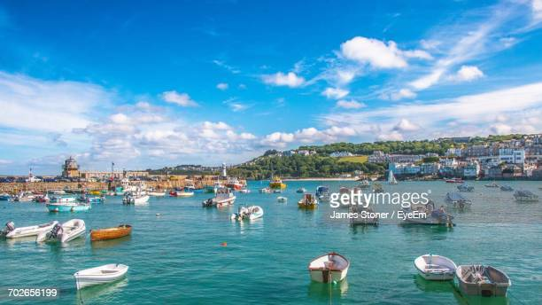view of boats in city - plymouth stock photos and pictures