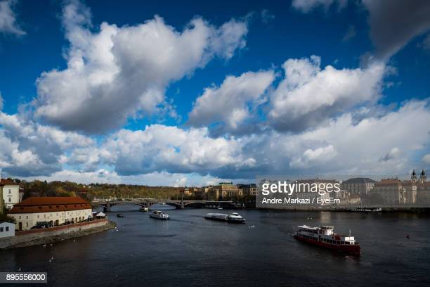 View Of Boats In River Against Cloudy Sky
