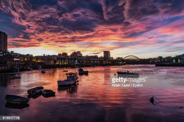 view of boats in river at sunset - sunderland stock pictures, royalty-free photos & images